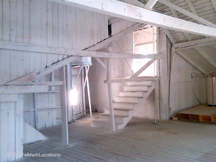 whitewashing inside a barn