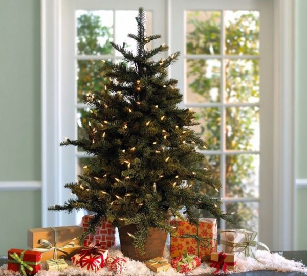 decorating a small home for christmas needs a smaller tree