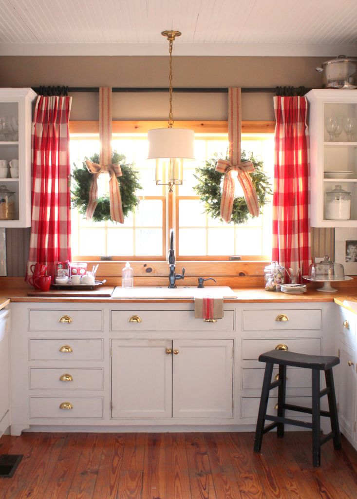 decorating a small home for christmas with pretty window decorations
