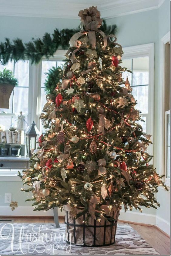 I love this idea for decorating your Christmas tree because you can still go traditional on the actual tree décor.