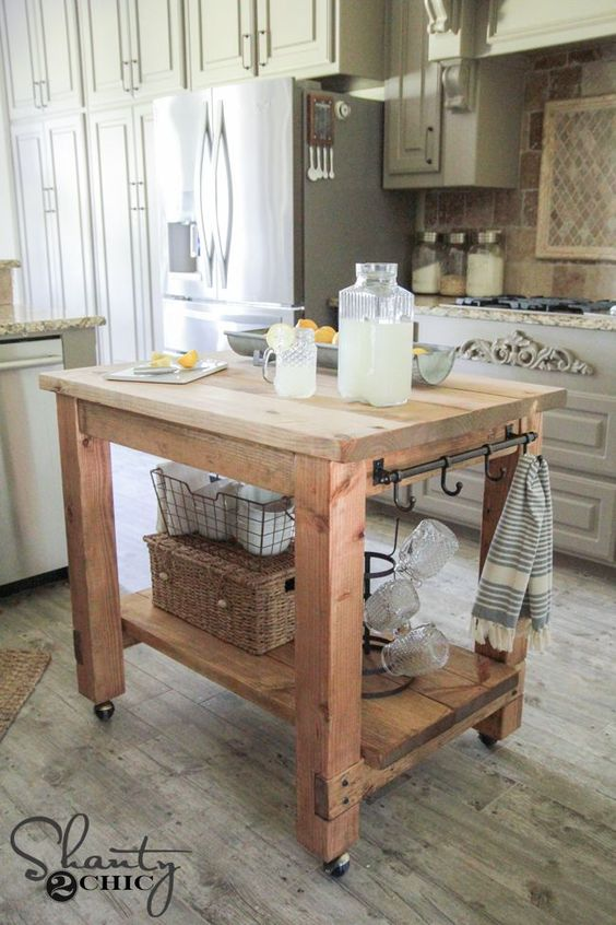 25 gorgeous diy kitchen islands to make your kitchen run smoothly rh morningchores com build a kitchen island with cabinets build a kitchen island table