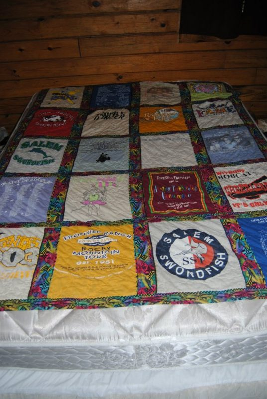 3f1f50e6 Here's a picture of the T-shirt quilt that my mother-in-law made me. There  are so many T-shirts on there that have special meaning from my  cheerleading days ...