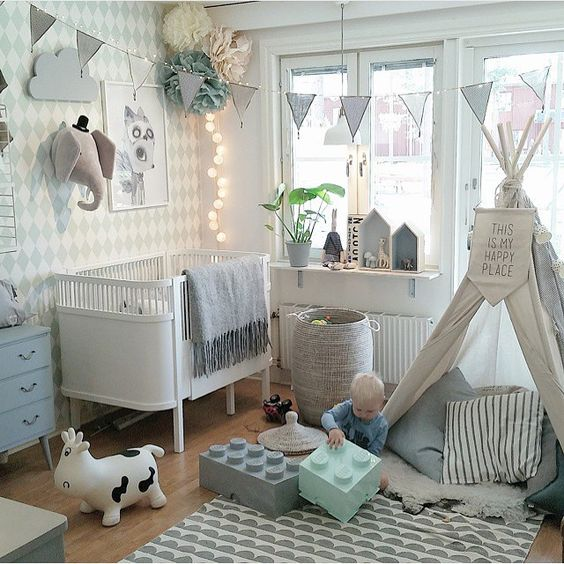 Baby Boy Nursery Decor Ideas This nursery is filled with toys to play with, art to wonder at, and a warm  dreamy vibe.