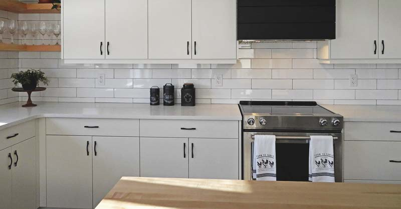How To Refinish Your Kitchen Cabinets And Give It An Instant New