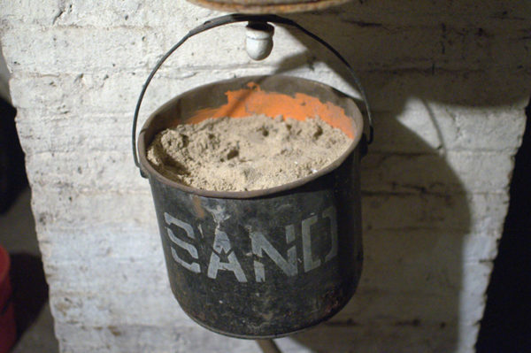 A black bucket full of sand