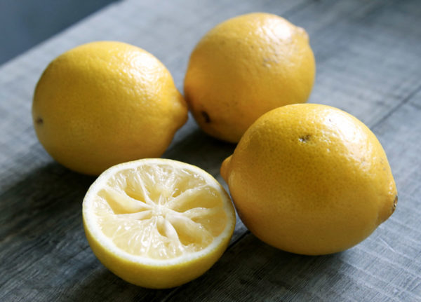 Sliced lemons on a wood table