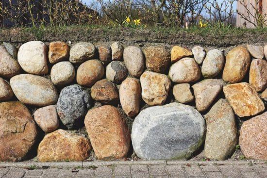 How to Build a Dry Freestanding Stone Wall the Right Way